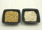 Bowls Of Chinaware With Oat And Porridge On Beige Placemat