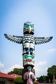 stock photo of totem pole  - Totem pole is symbolic monuments with sculptures carved from large trees - JPG