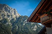 picture of chalet  - Rustic Photograph Of A Traditional Alpine Chalet In The Summer - JPG