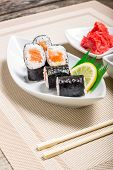 Traditional Maki Sushi Served With Wasabi And Ginger