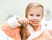 Cute Little Girl Brushing Teeth In Bath