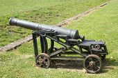stock photo of artillery  - cannon or artillery or an old macine or weapon - JPG