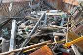 stock photo of scrap-iron  - piles of scrap iron with broken and rusted objects in a waste landfill - JPG