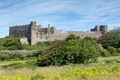 stock photo of west village  - Manorbier Castle is a Norman castle located in the village of Manorbier five miles south - JPG