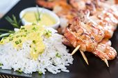 picture of tiger prawn  - Fresh fried Tiger Prawns on a spit