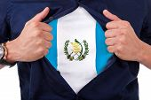 Young Sport Fan Opening His Shirt And Showing The Flag His Country Guatemala, Guatemalan Flag
