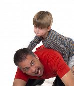 a boy on his father's back, parenting can be difficult
