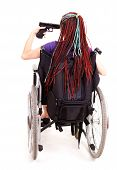 Trendy Woman With Gun On The Wheelchair, White Background