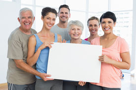 image of senior class  - Portrait of happy fit people holding blank board in the yoga class - JPG