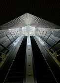 Long Escalators Lead Out Of An Underground Passage