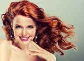 pic of hair curlers  - Beautiful girl with long curly red hair - JPG