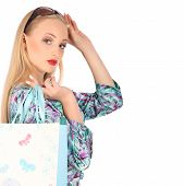 Young Pretty Woman Standing With Colourful Shopping Bags