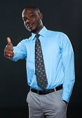 Young Successful Businessman Showing Thumb Up