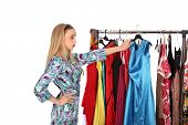 Which Dress Should I Pick, Young Woman Holding Wear