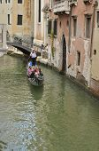 Gondola Crossing A Small Canal
