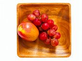 Apple And Grapes In A Wooden Bowl