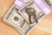 House Keys On Stack Of Money