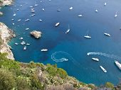 Boats Drifting In A Calm Bay