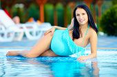 Beautiful Pregnant Woman Posing Near The Pool