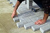 stock photo of stone house  - builder worker tiler tile stores built walkway or path - JPG