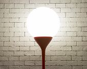 foto of lamp shade  - Lamp With Circle Shape On White Bricks texture Background  - JPG