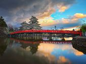 stock photo of emperor  - Matsumoto castle and red bridge in Nagano - JPG