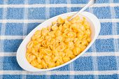 dMacaroni And Cheese With Fork On Blue Towel
