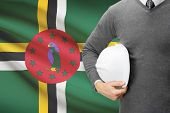 Architect With Flag On Background  - Dominica