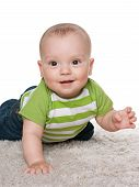 Smiling Baby Boy On The White Carpet