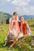 Lovers pants in fashionable traditional Bavarian Dirndl and leather with hat