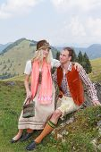Bavarian couple in love in traditional costume clothing
