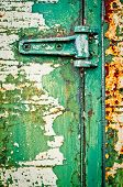 Hinge On Rusty Metal Door With Cracked Paint