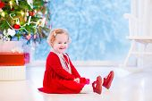 Beautiful Little Girl Under Christmas Tree