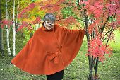 Happy Mature woman in autumn Park. Autumn age.