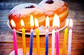 Candles And Fresh Doughnuts With Jam