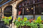 Luxury public house in Mayfair, decorated with flower baskets