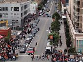 Crowd Of People Walk Along Sidewalk Towards World Series Game