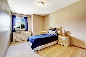 Bedroom Interior With Navy Bedding And Curtains