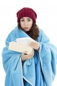 picture of shivering  - Woman sick and feeling cold holding a tissue piece in her hand - JPG