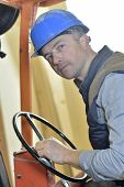 Man driving warehouse trolley in carpentry factory