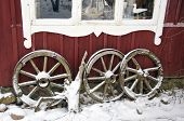 picture of carriage horse  - ancient horse carriage wheels collection near farm house and winter snow - JPG