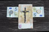 Euro Money Cross And Metal Crucifixion Concept