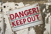 stock photo of dangerous  - Closeup of weathered Danger Keep Out sign - JPG
