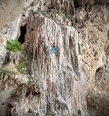 pic of incredible  - Young female rock climber on incredible wall Railay Beach in Thailand - JPG