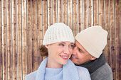 Casual couple in warm clothing against wooden planks