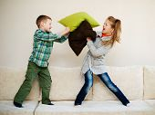 pic of pillow-fight  - boy fights with girl pillow at home - JPG