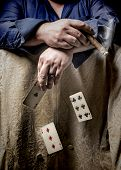 foto of hustler  - Man smoking a cigar and playing poker with falling cards - JPG