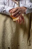 Man drinking a glass of spirits