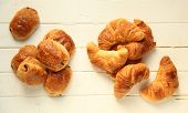 Croissant and pain au chocolat, french pastries on white wooden background