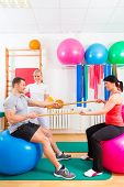 foto of physical therapist  - Patients at the physiotherapy doing physical exercises with therapist - JPG
